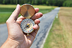 #76267495  Compass in the hand © HappyAlex - Fotolia