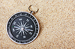 #63748988 compass in the sand © OlegDoroshin - Fotolia